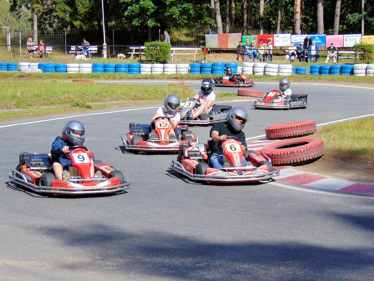 Multiple people driving a go kart